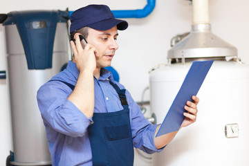 Plumber talking at the phone