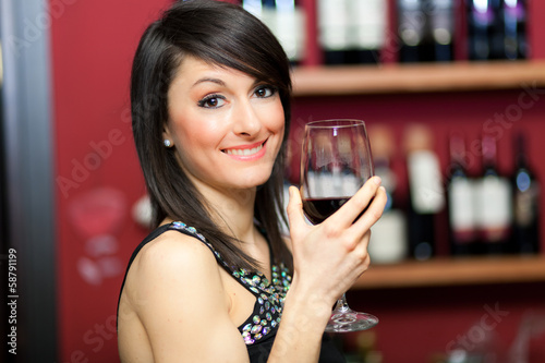 Woman drinking wine at the restaurant