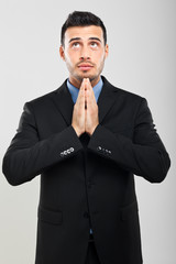 Businessman praying in supplication
