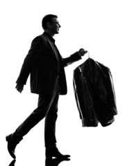 business man holding dry clean clothes  silhouette