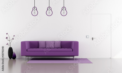 Purple sofa in a minimalist white lounge