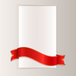 Red ribbon bending around blank paper card