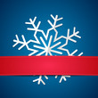 Paper snowflake on colored background