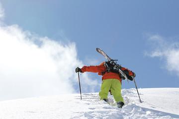 Skier climbing a snowy mountain