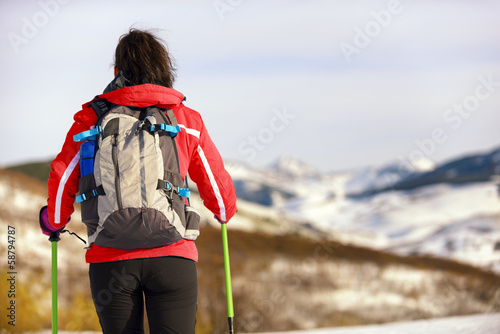 Woman hiking rear view