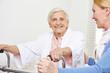 Senior woman with geriatric nurse