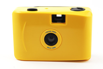 yellow camera shoot and go over white