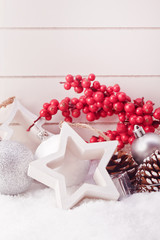 white star and christmas ball decoration with red berries