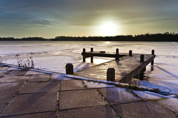Cool Colored Sunrise over Lake in Winter
