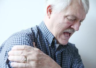 bad pain in shoulder of senior man