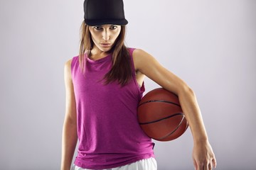 Female basketball player looking confident