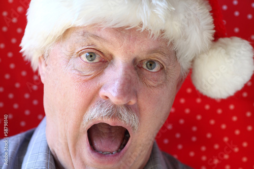 Santa hat on man looking alarmed