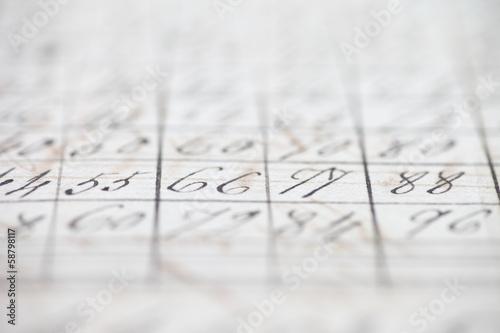 closeup of vintage handwritten numbers