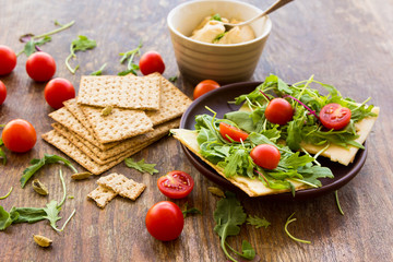 Vegetarian crispbread  with tomatos, cheese and salad mix