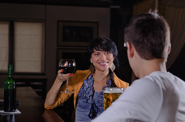 Smiling young woman chatting to her boyfriend