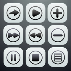 set of buttons in white with black icons on them