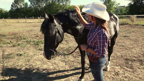 Young Woman with Black Stallion Horse