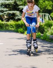 Teenage girl having fun on a scooter