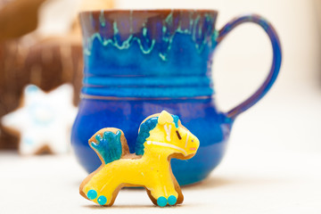 Blue mug and christmas gingerbread cake pony icing decoration
