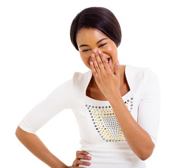 african woman covering her mouth and laughing