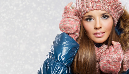 Smiling beautiful woman with winter hat and scarf