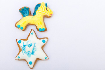 Gingerbread cake pony star with icing decoration on white