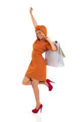 young african woman holding shopping bags