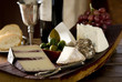 Closeup of a cheese platter in a rustic setting.