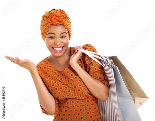 african woman in traditional clothes carrying shopping bags