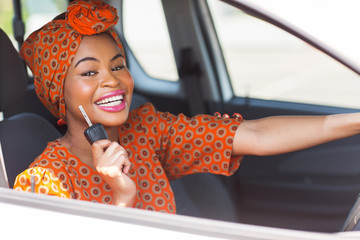 african woman showing car key