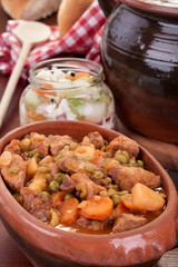 Traditional goulash or pork stew, in red crock pot