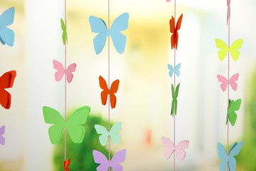 Handmade paper garland on bright background