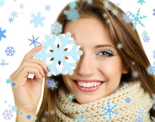 Beautiful smiling girl with Christmas snowflake isolated