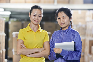 two chinese female workers in warehouse