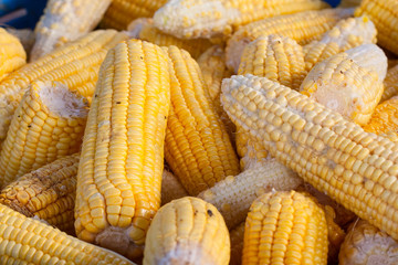 Corns are piled for sell.