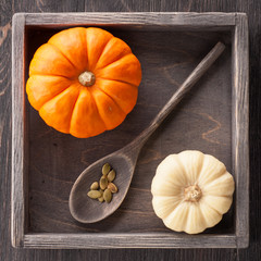Pumpkins in a vintage wooden box