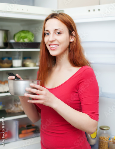 Happy long-haired woman with pan
