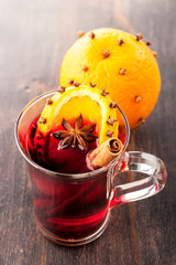 Hot mulled wine with spices and orange