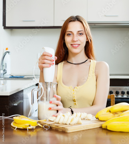 cheerful housewife cooking with bananas
