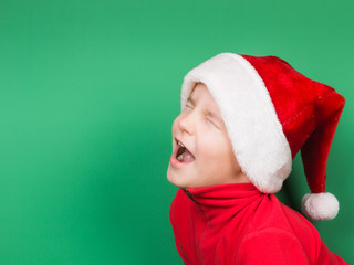 Santa boy playing on green background