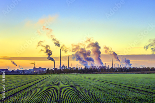 industry complex in Frankfurt in early morning with green fields