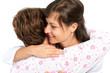 A senior woman and caregiver hugging