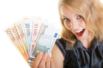 Rich happy business woman showing euro currency money banknotes