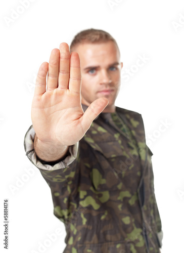 Army soldier making stop sign