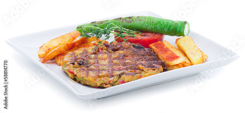 Vegetarian food on plate with french fries isolated on white