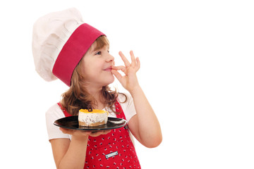 happy little girl cook with cake and ok hand sign