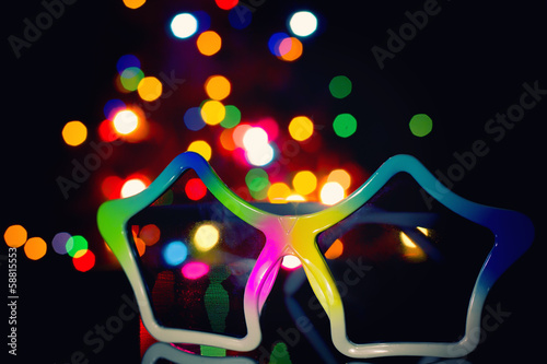 Party disco background, sunglasses on foreground
