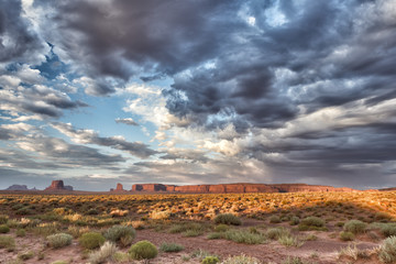Monument Valley view on cloudy sky background