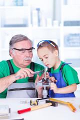 Grandfather showing grandchild the vernier caliper