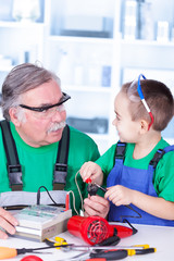 Grandfather and grandchild using multimeter